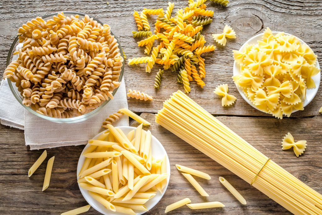 Different types of raw pasta on a table