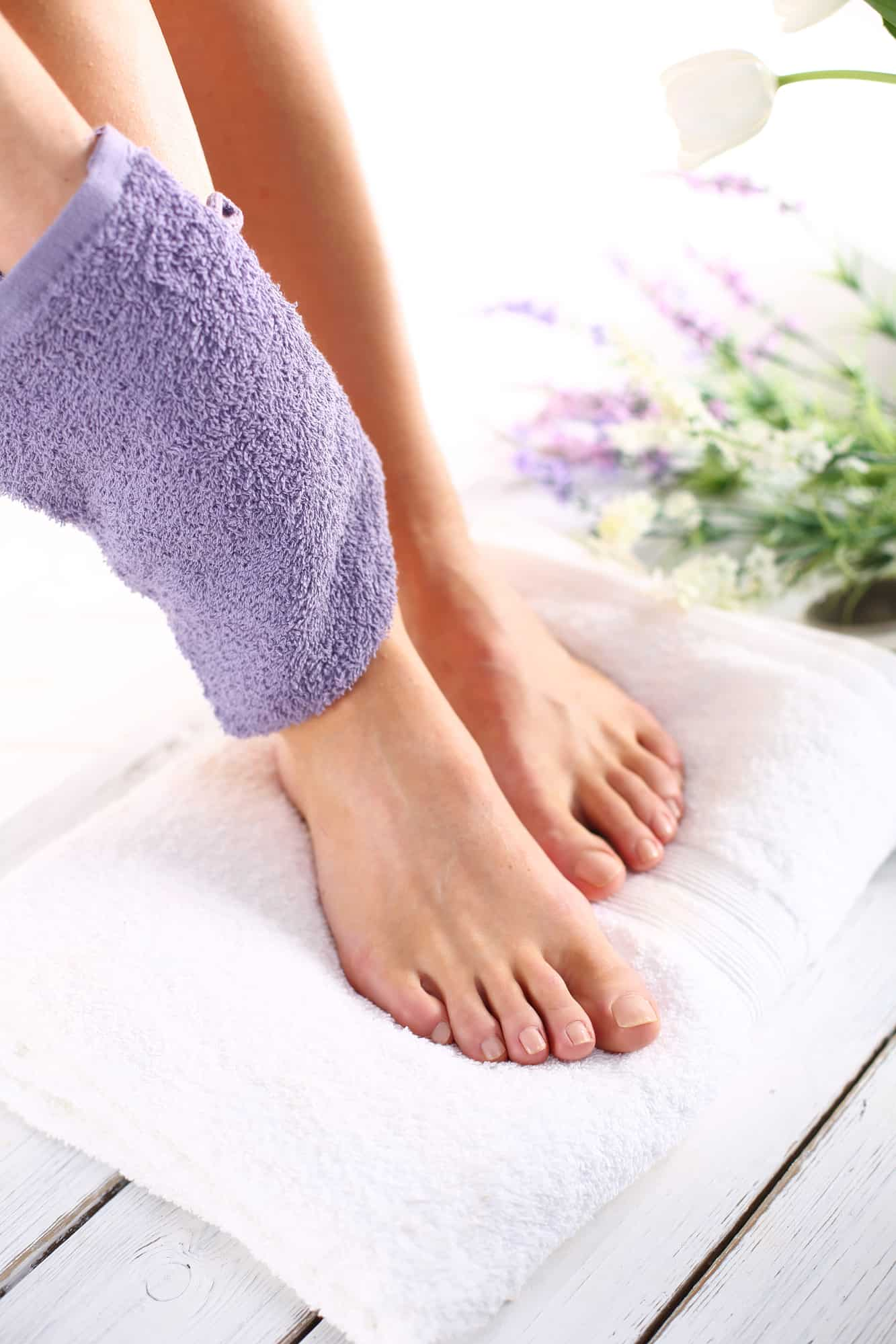 woman rubbing leg with a towel for better circulation