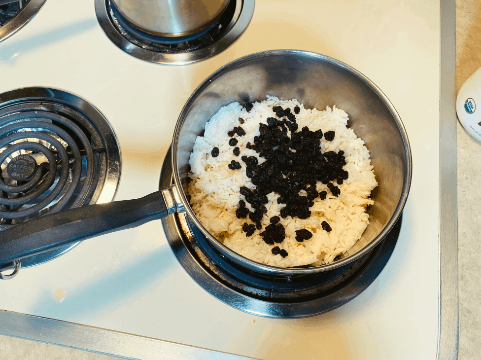 Cooked rice and raisins in pot